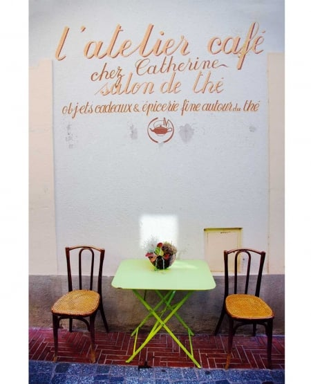 L'atelier café. Table with basket, bathed in early morning sun